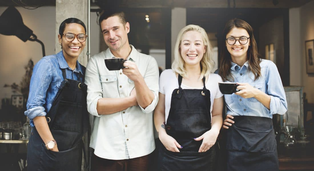 Restaurant Employees Outside Cafe 1100x600
