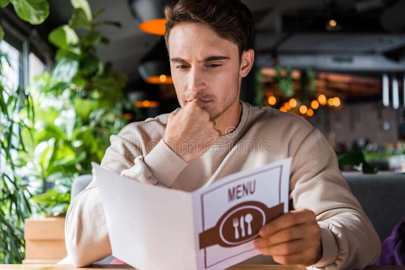 Man Touching Face Reading Menu Handsome 199134385